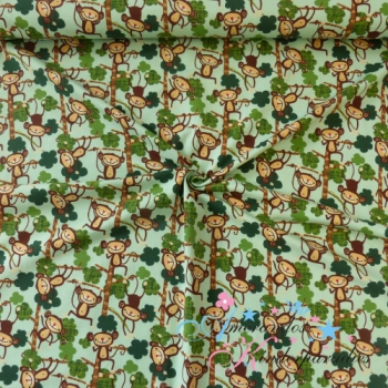 Baumwolljersey Äffchen im Baum auf hellgrün