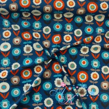 Baumwolljersey Löwenblümchen orange türkis auf blau ~ Retro